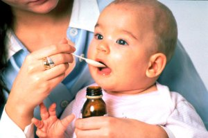Baby swallowing medicine